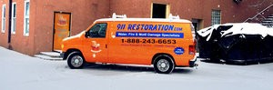 Water Damage Washington Restoration Van At Snowy Civic Job Site