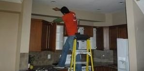 Water Damage Restoration Pro Conducting Ceiling Repair